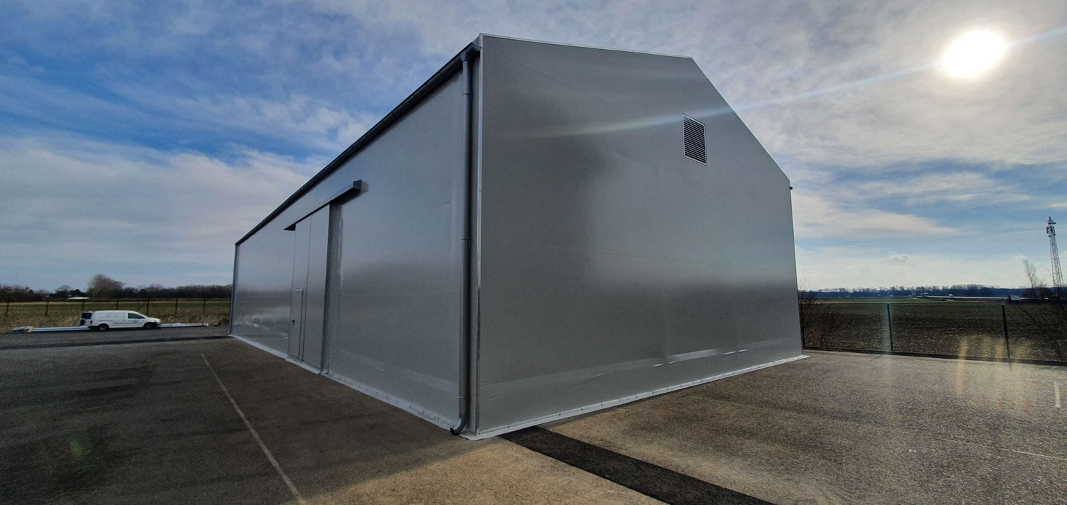 Storage fabric structure with racks for Holter company